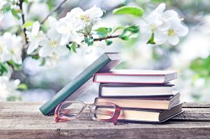 Pile Of Books And Glasses Outdoors Spring Or Summertime